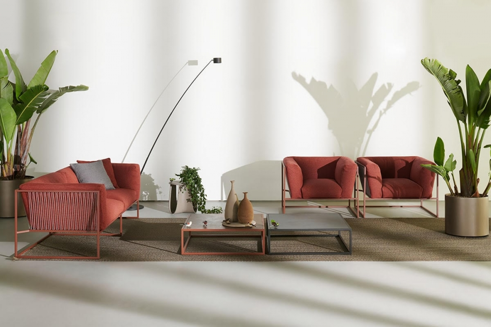 ARPA indoor and outdoor sofa, armchair and side table by RAMÓN ESTEVE, designed in 2020. As its name implies, ARPA collection is inspired by the harp, one of the most beautiful and mesmerizing musical instruments. Unlike the meticulous work involved in manufacturing a harp, in designing this collection, rigorous paring down was applied, resolving each piece with the least possible number of elements. ARPA collection combines the stability of the orthogonal external shape with the softness and comfort of the inner cushion shell. The thin strings add elegance and fineness to every piece, giving a special sense of lightness, as if the whole cushion mass was hanging from the structure. Designed to be timeless, ARPA aims to become an icon, not only for aesthetical reasons, but also for its functionality and comfort.
